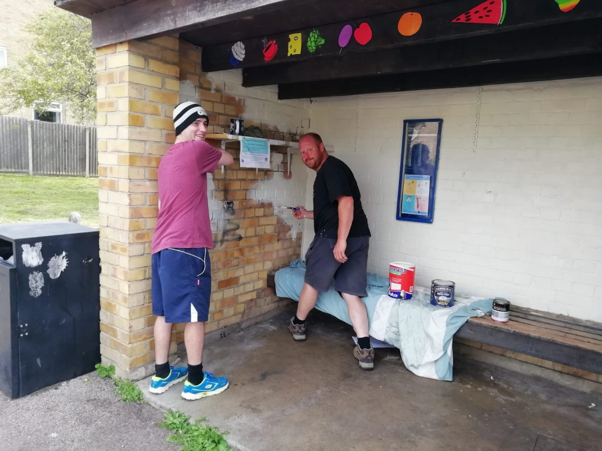 Ollie and Chris give the Bus Stop Shop a lick of paint