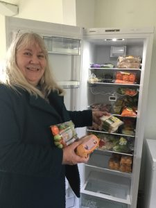 Jaqui Smith helping fill the fridge with food donated by local supermarkets which we share with our community